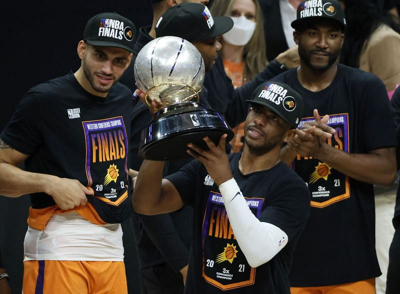 Chris Paul (#3) holds the Western Conference Championship trophy.
