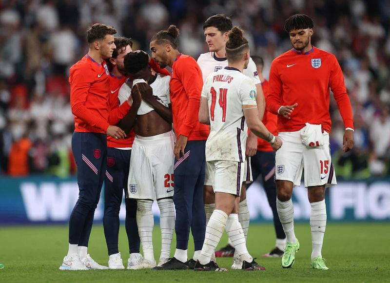 Bukayo Saka being consoled by his team-mates after missing the penalty against Italy