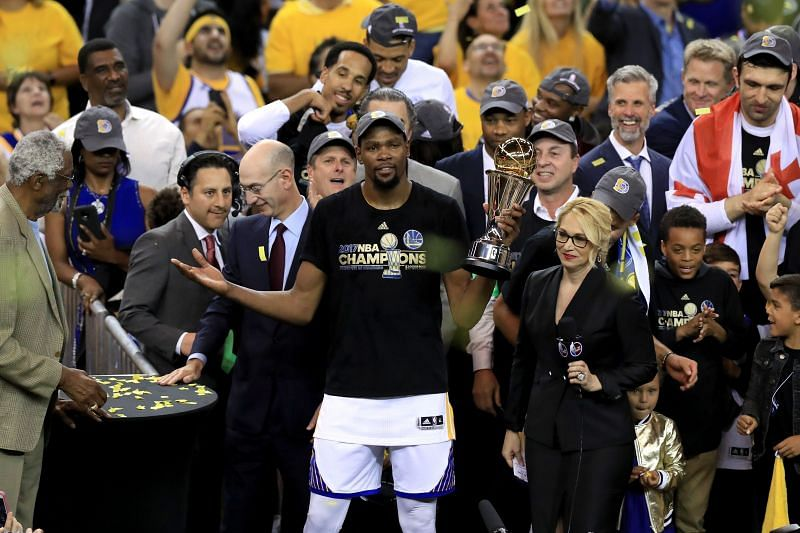 Kevin Durant #35 of the Golden State Warriors celebrates with the Bill Russell NBA Finals MVP Award.