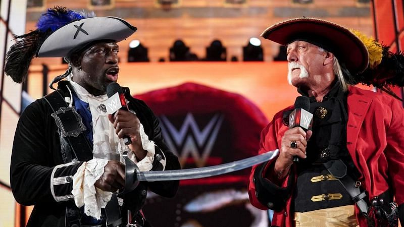 Hulk Hogan and Titus O'Neil performing on the WrestleMania stage