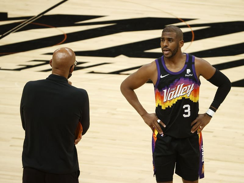 Chris Paul #3 talks with head coach Monty Williams during the first half in Game 5.