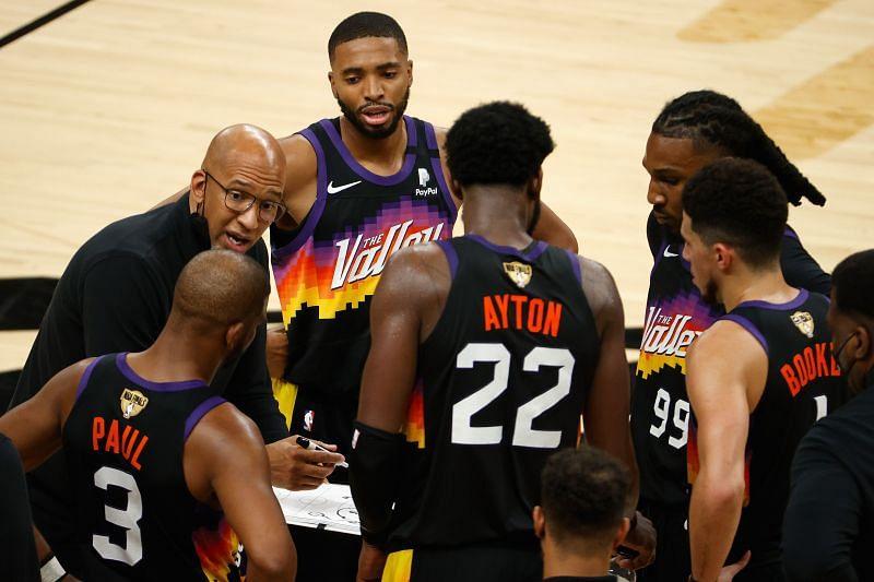 Phoenix Suns head coach Monty Williams talks to his starters