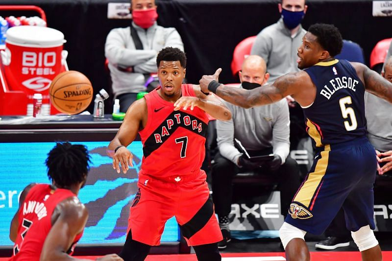 Kyle Lowry #7 passes the ball to OG Anunoby #3.