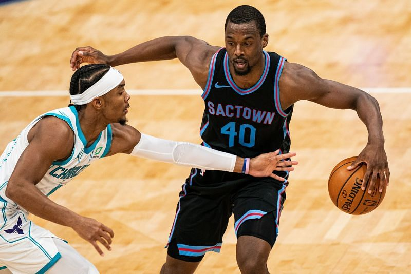 Harrison Barnes #40 of the Sacramento Kings brings the ball up court while guarded by Devonte' Graham #4 of the Charlotte Hornets