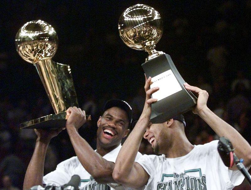 David Robinson and Tim Duncan celebrate after winning the NBA championship.