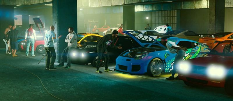 Some NPCs tuning up their rides (Image via Rockstar Games)