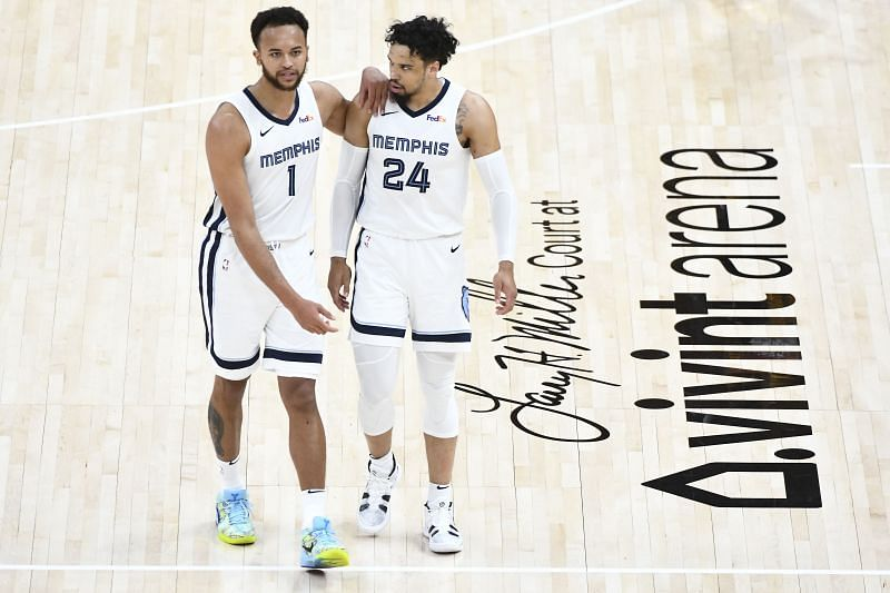 Kyle Anderson #1 speaks with Dillon Brooks #24 of the Memphis Grizzlies.