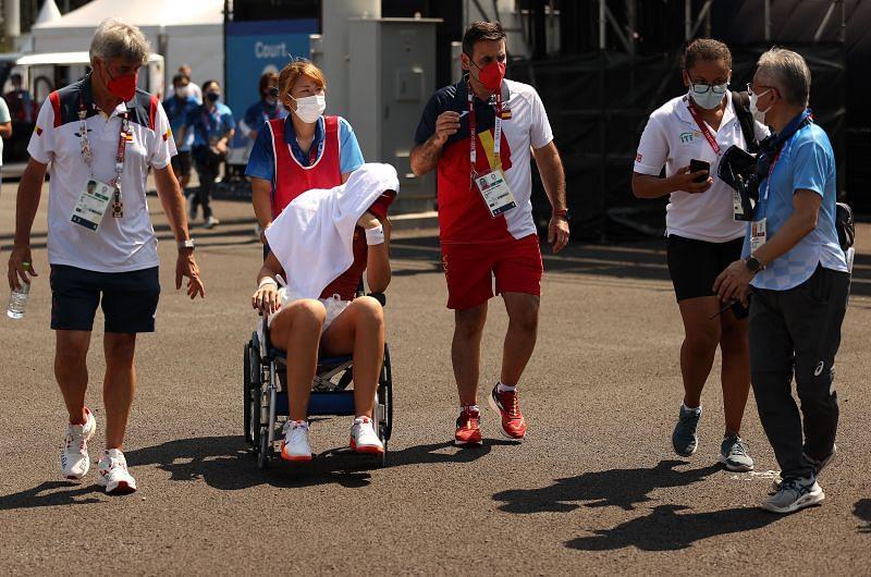 Paula Badosa being wheelchaired away