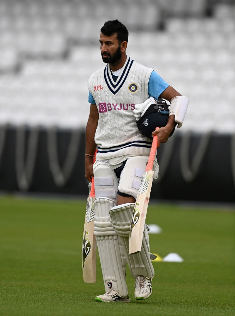 Cheteshwar Pujara walks to the nets for his session.