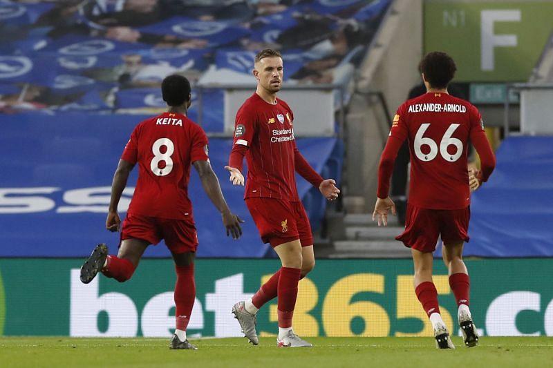 Jordan Henderson (centre) has been a regular fixture in Liverpool