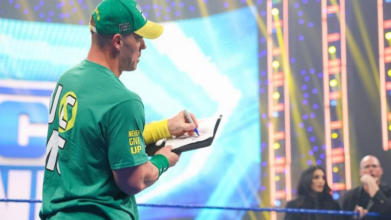 John Cena steals title match against Roman Reigns