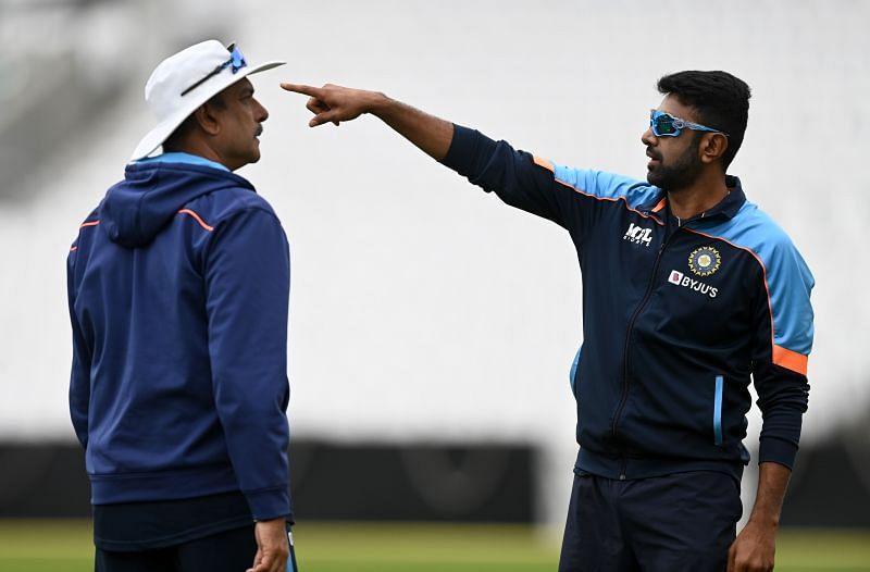 Ravichandran Ashwin from India speaks with coach Ravi Shastri.