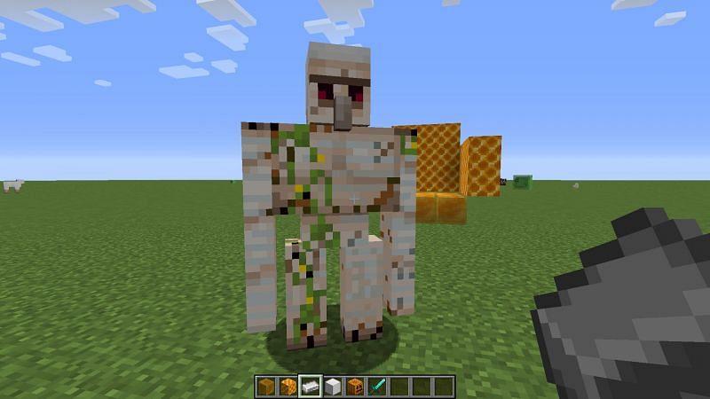In Minecraft: Java Edition, iron golems can be healed via having iron ingots used on them. (Image via Mojang)