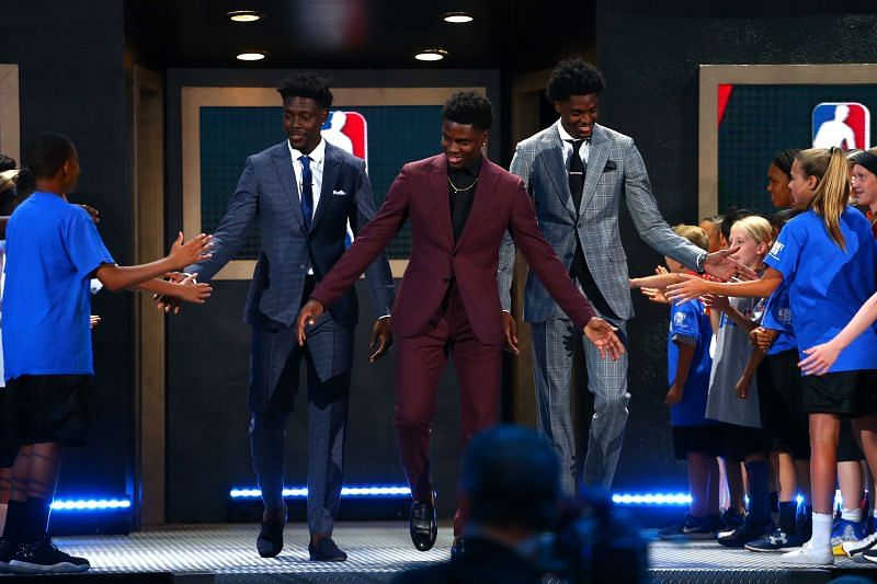 Aaron Holiday (C) poses with brothers Justin Holiday and Jrue Holiday