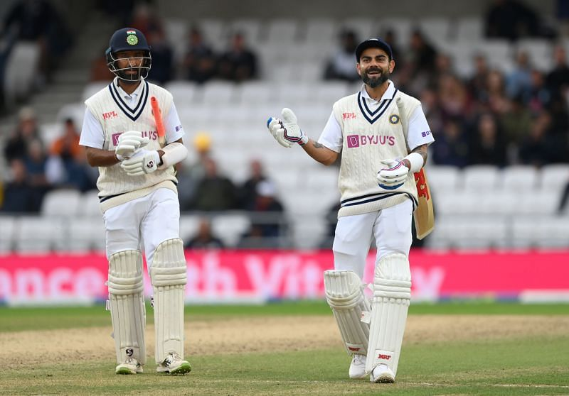 Indian batsmen Virat Kohli (right) and Cheteshwar Pujara leave the field after day three of the Headingley Test. Pic: Getty Images