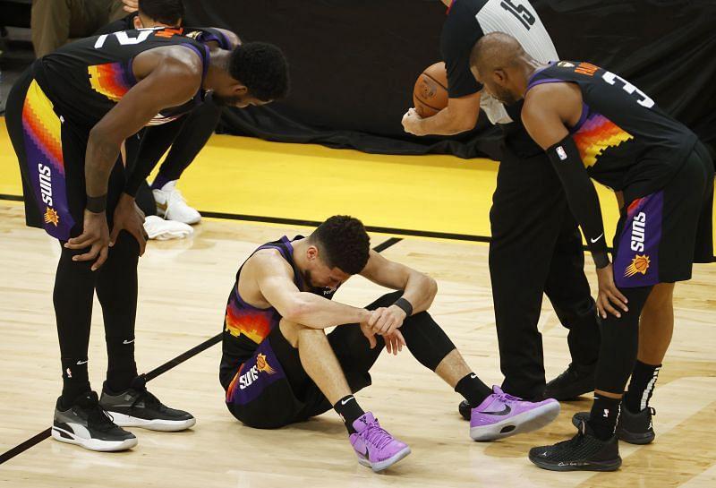 Chris Paul consoles backcourt partner Devin Booker in the NBA Finals