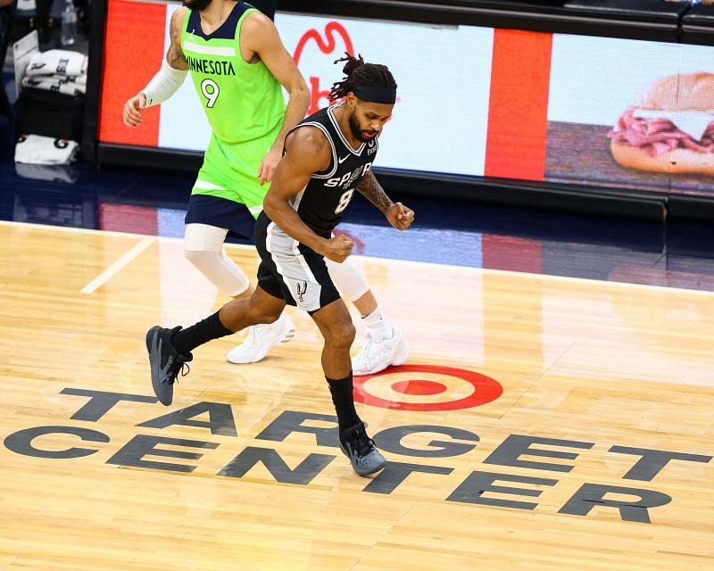 Patty Mills (#8) reacts on the court