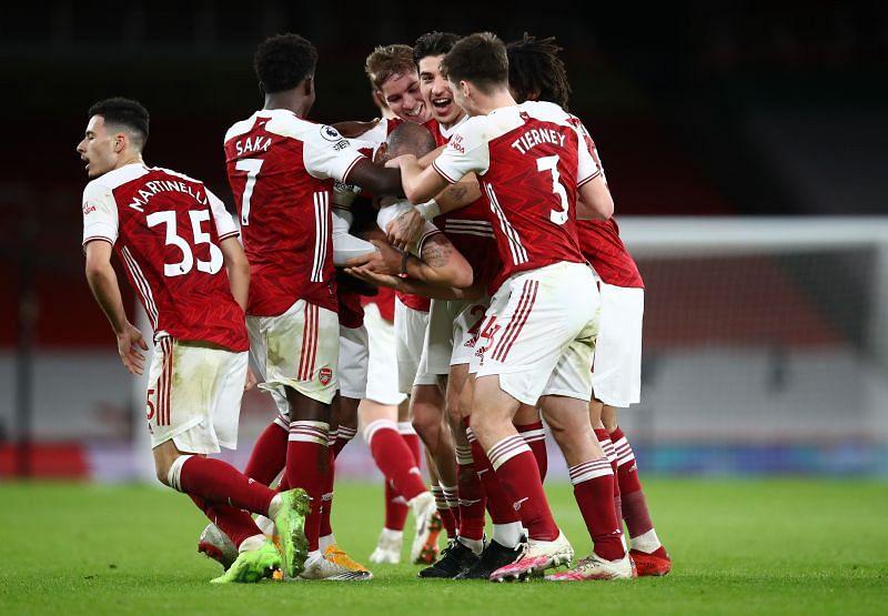 Arsenal players celebrating following a goal