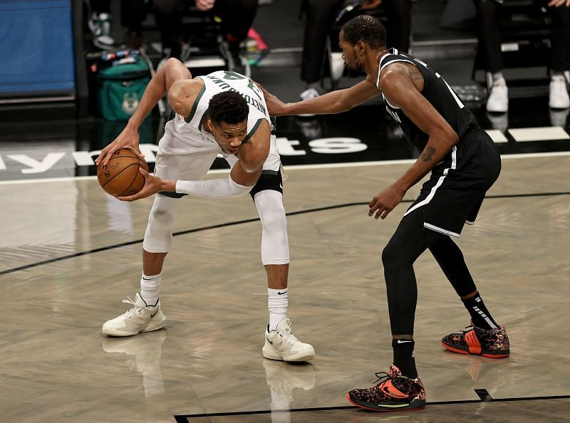 Giannis Antetokounmpo (#34) of the Milwaukee Bucks heads for the net as Kevin Durant (#7) of the Brooklyn Nets defends.