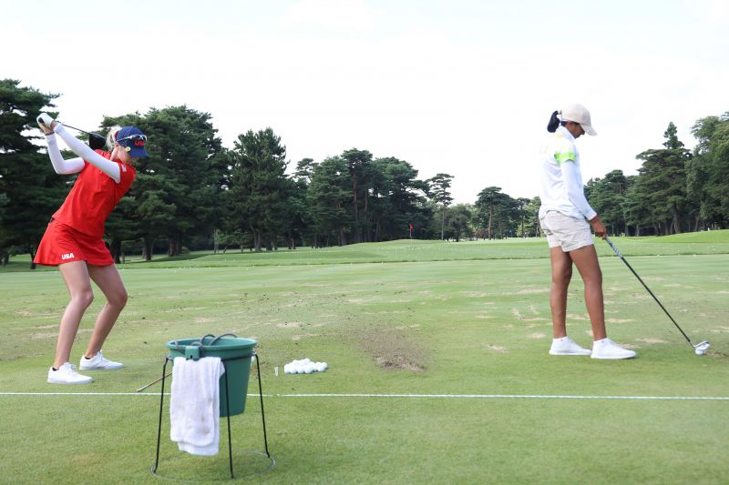 USA's Nelly Korda and India's Aditi Ashok on the practise grounds before round four on Saturday