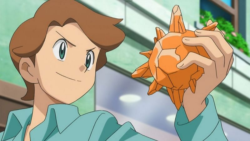 A Trainer holding a Sun Stone in the Anime (Image via The Pokemon Company)