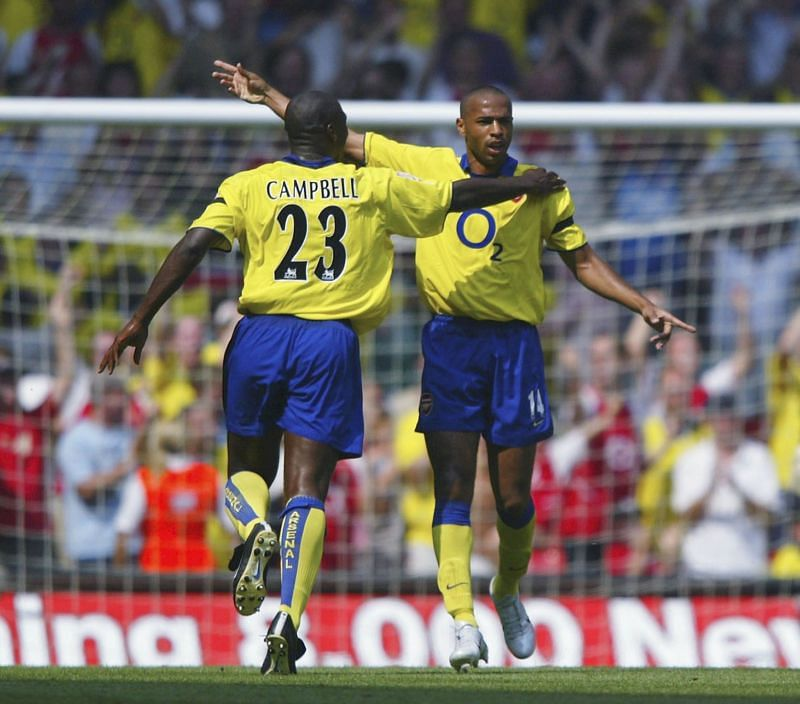 Thierry Henry celebrating after scoring against Manchester United in the 2003 Community Shield clash