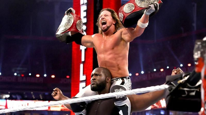 Omos (7ft 2in) celebrating with AJ Styles (5ft 9in)