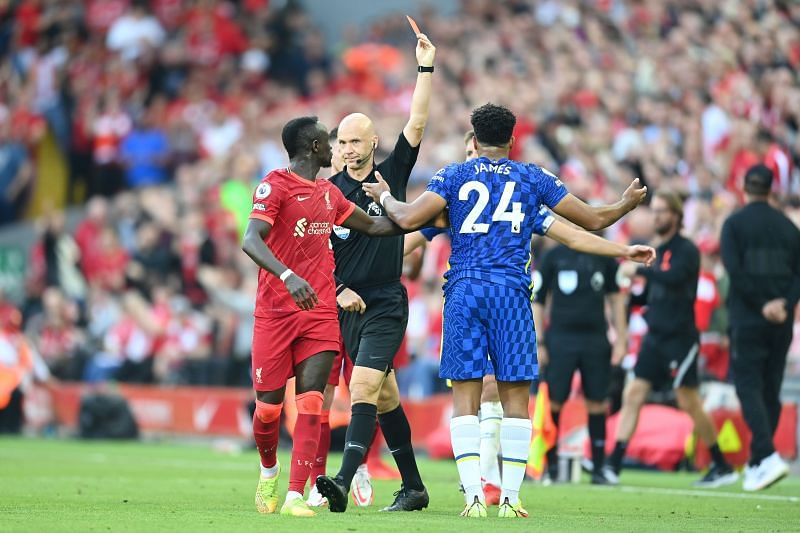 Reece James received a straight red card in the first half for deliberately handling the ball on the line,e