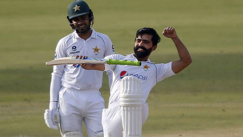 Fawad Alam (R) celebrates after reaching his century