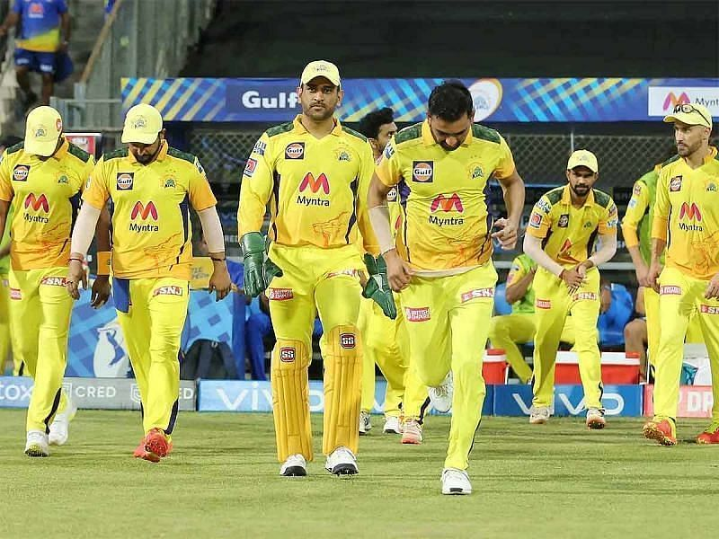 MS Dhoni leads his team into the field