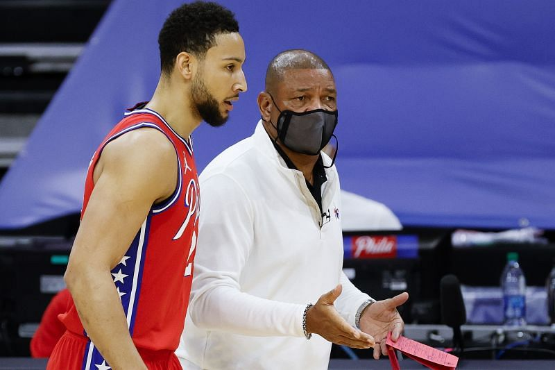 Head coach Doc Rivers speaks with Ben Simmons #25.