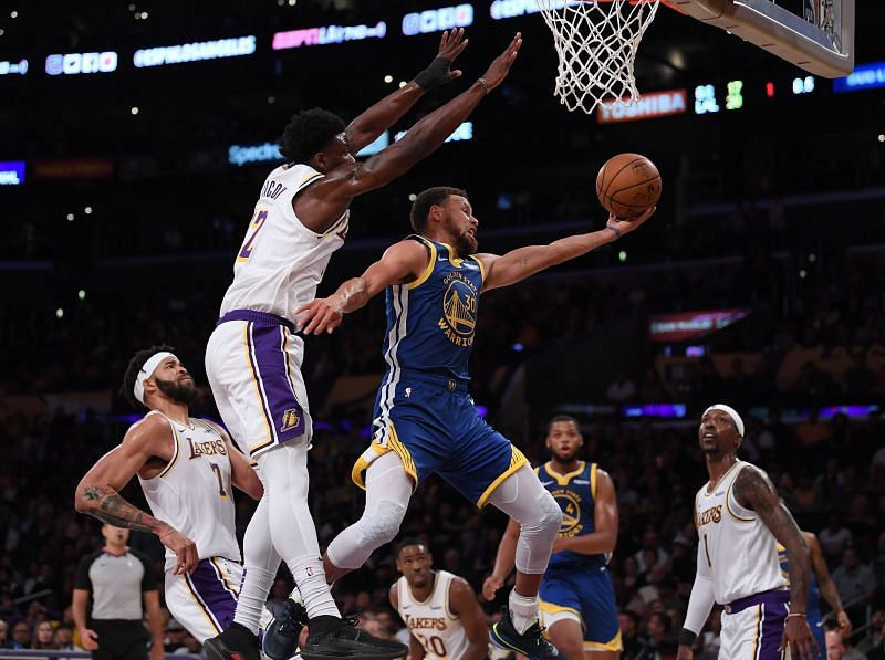 Devontae Cacok battles Stephen curry in the air
