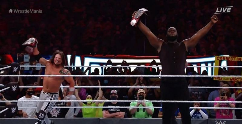 AJ Styles and Omos following their win at WrestleMania