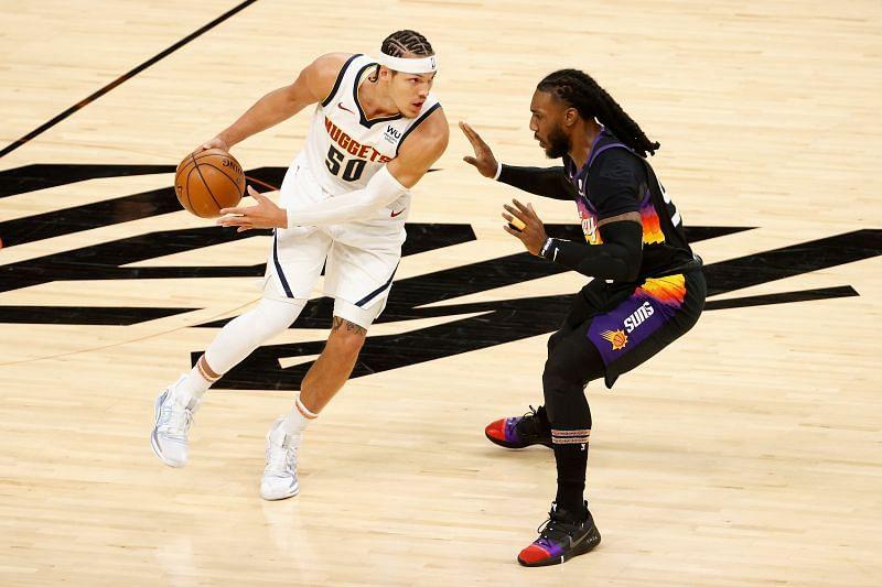 Aaron Gordon tries to drive against Jae Crowder during the 2021 NBA Playoffs