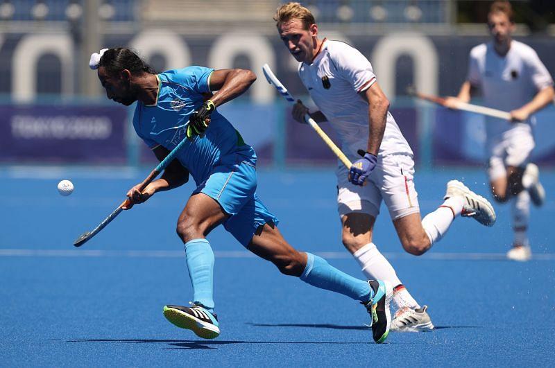Indian men's hockey team midfielder <a href='https://www.sportskeeda.com/player/hardik-singh' target='_blank' rel='noopener noreferrer'>Hardik Singh</a> in action against Germany at <a href='https://www.sportskeeda.com/go/tokyo-olympics-2020' target='_blank' rel='noopener noreferrer'>the Tokyo Olympics</a>.