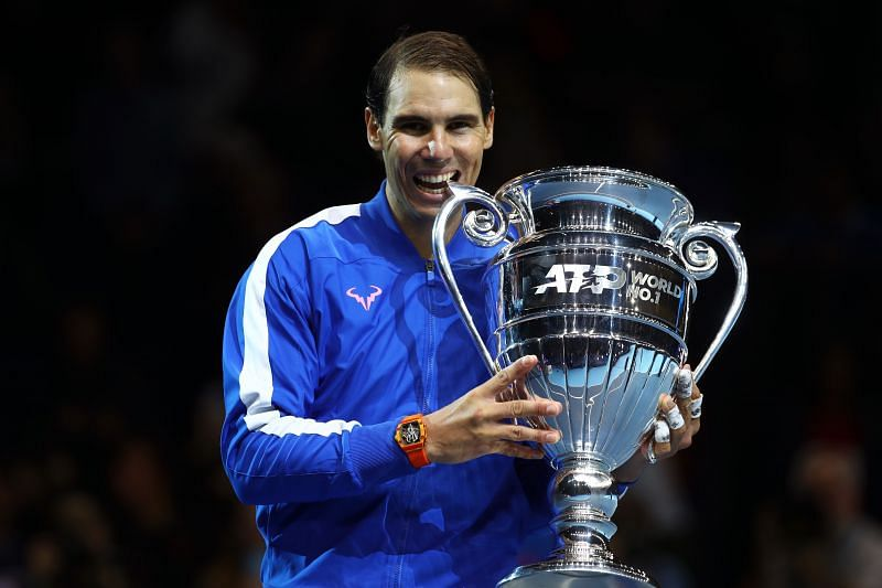 Rafael Nadal poses with the 2019 year-end Wolrd No. 1 trophy