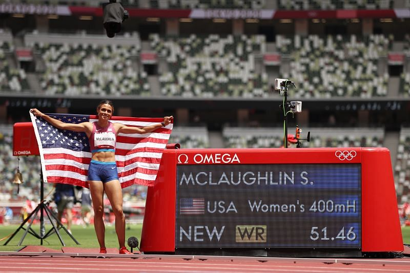 Sydney McLaughlin poses after creating a world record at the Tokyo Olympics.