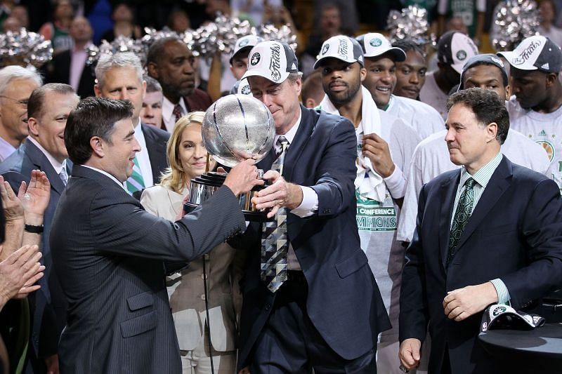 Team owner Wyc Grousbeck of the Boston Celtics receives the Eastern Conference trophy from Dave Cowens