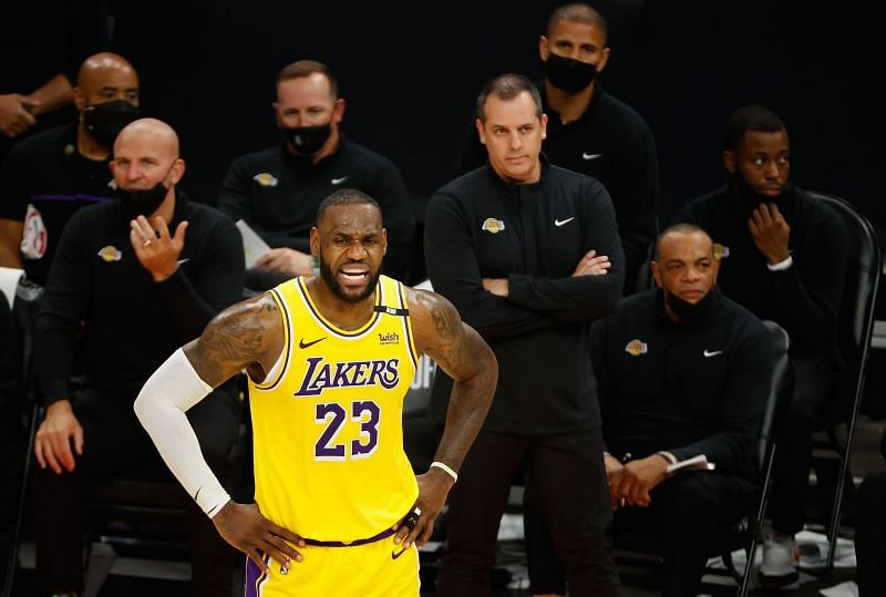 LeBron James #23 of the Los Angeles Lakers reacts ahead of assistant coach Jason Kidd and head coach Frank Vogel during the second half of Game Two of the Western Conference first-round playoff series at Phoenix Suns Arena on May 25, 2021 in Phoenix, Arizona.