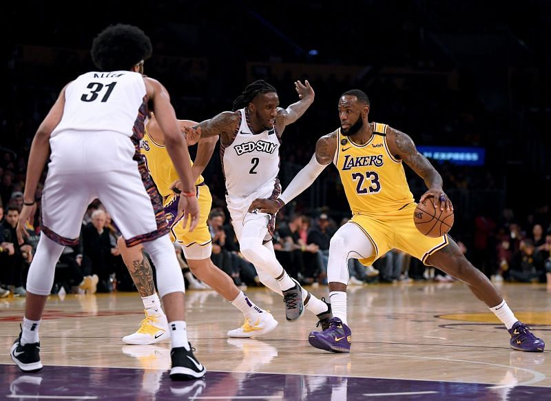 LOS ANGELES, CALIFORNIA - MARCH 10: LeBron James #23 of the Los Angeles Lakers drives to the basket on Taurean Prince #2 of the Brooklyn Nets and Jarrett Allen #31 during a 104-102 Nets win at Staples Center on March 10, 2020 in Los Angeles, California.