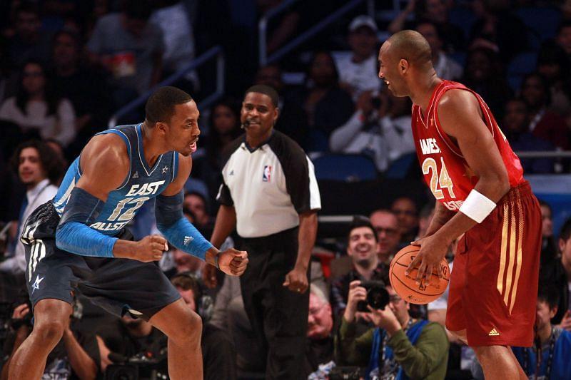 Kobe Bryant #24 goes up against Dwight Howard #12