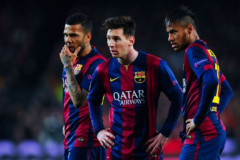 Messi (center) and Alves (left) have won plenty of trophies in their careers
