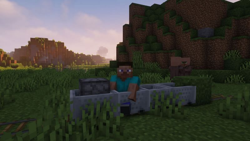 Steve sitting in a train of minecarts (Image via Minecraft)