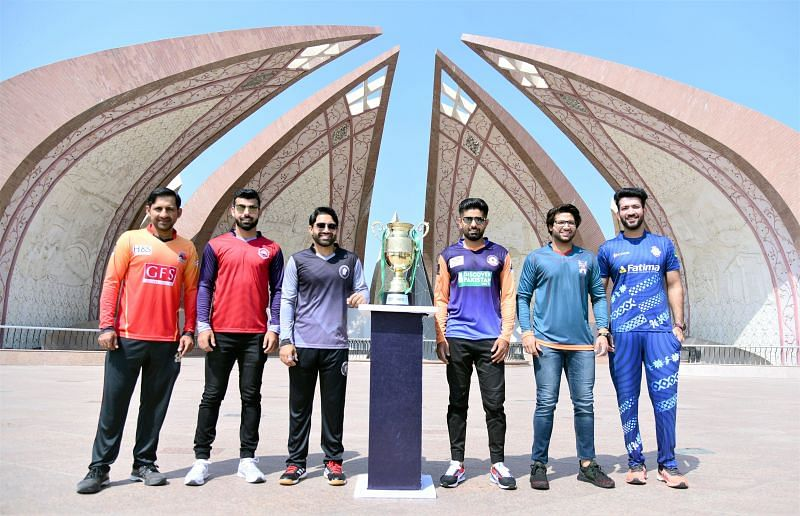 The captains of the six teams pose with the National T20 Cup 2021 trophy