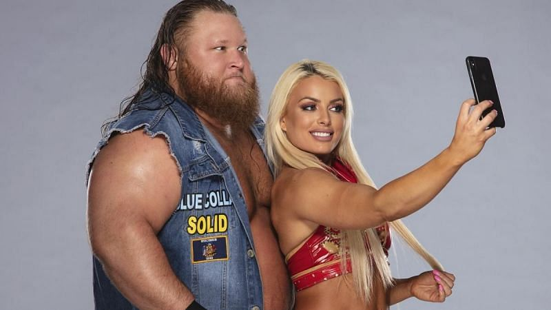 Mandy Rose taking a selfie with Otis backstage at a WWE event