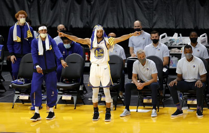 Stephen Curry and the Golden State Warriors celebrate their victory against the Denver Nuggets.