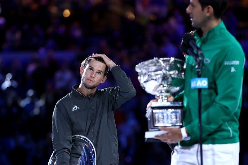 Thiem (L) and Djokovic at the 2020 Australian Open trophy presentation ceremony.