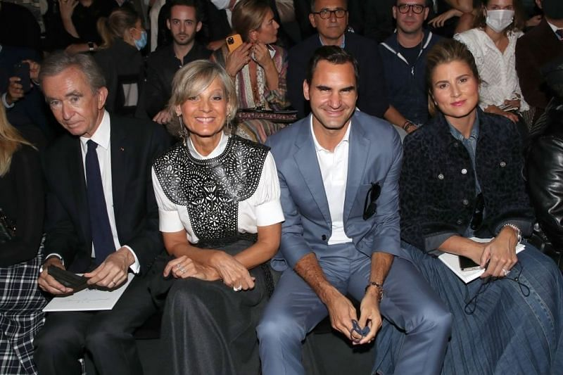 Roger Federer and wife Mirka seated to watch Dior's show