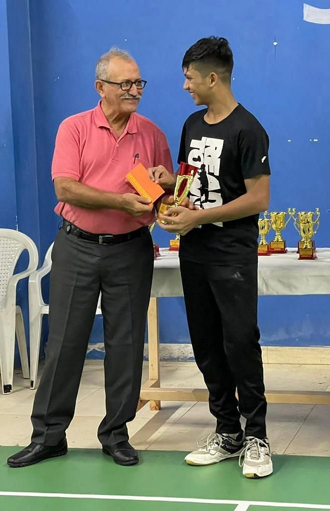 Mohd Ali Mir receiving the trophy from the chief guest in Surat on Wednesday
