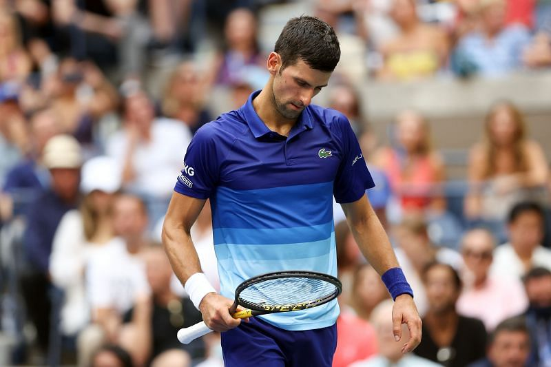 Novak Djokovic appears disappointed after a point
